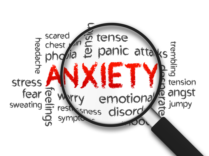 Magnified Anxiety word illustration on white background.